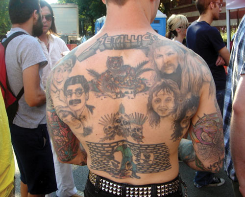recent fascination with Catholic and traditional tattoo imagery.